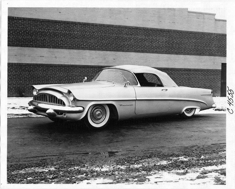 1954 Packard Panther-Daytona, seven-eights left side view, top raised, parked next to brick building