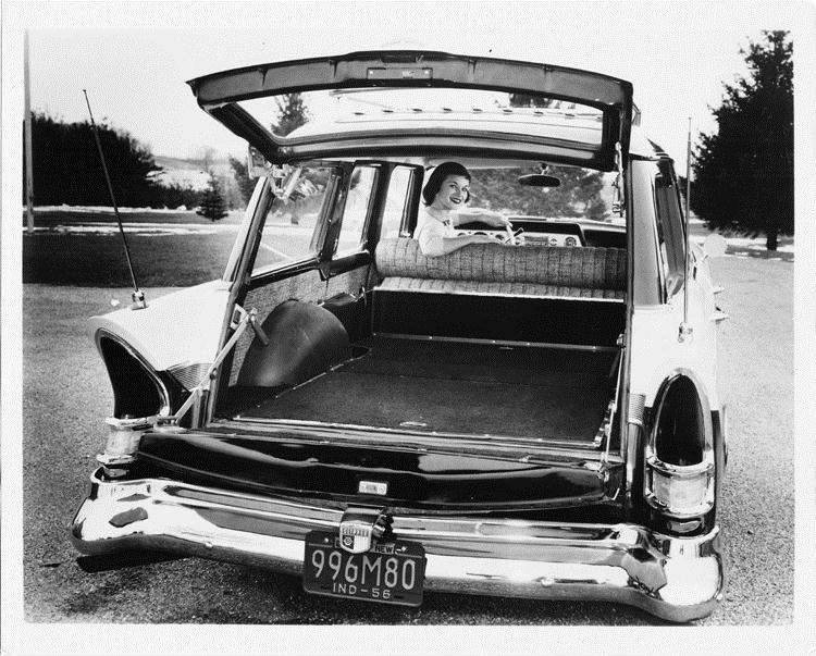 1957 Packard station wagon, female behind wheel looking over her shoulder