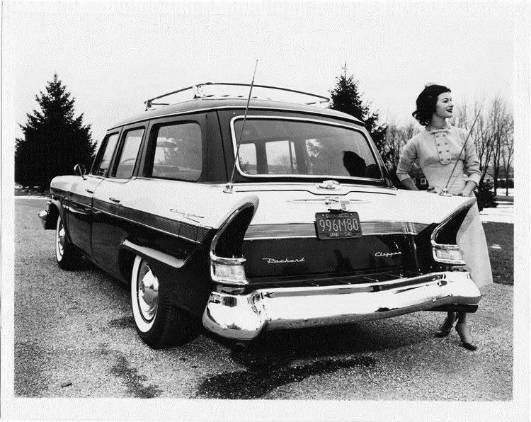 1957 Packard station wagon, rear view, female standing at passenger side