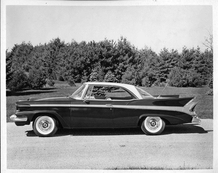 1958 Packard sedan, left side view, parked on drive
