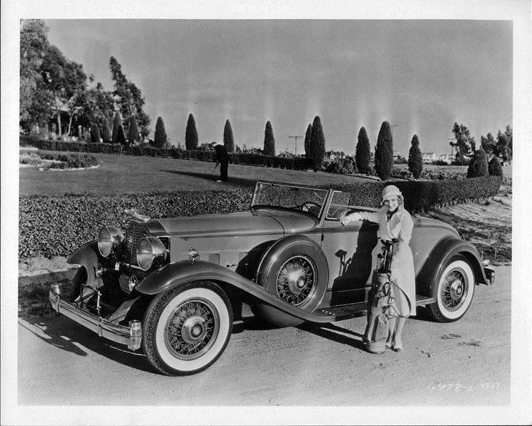 1932 Packard coupe roadster and owner Madge Evans with golf clubs