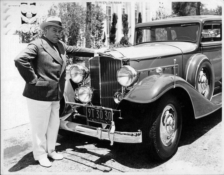 1933 Packard sedan and owner comic strip creator George McManus
