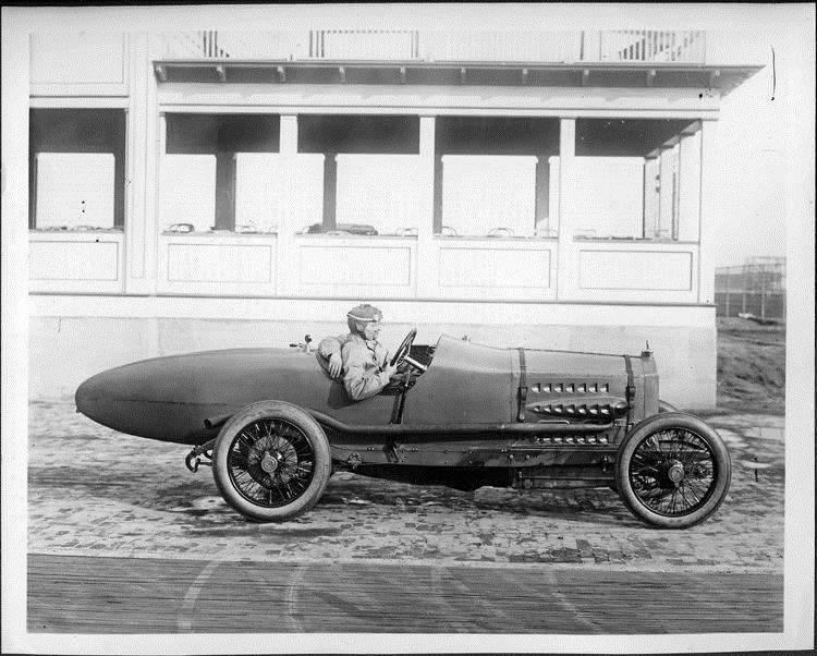 Packard 299 race car, left side view, two men inside