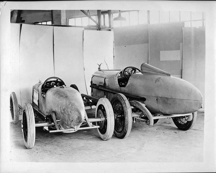 1923 Packard race car with 1919 Packard race car, three-quarter rear view
