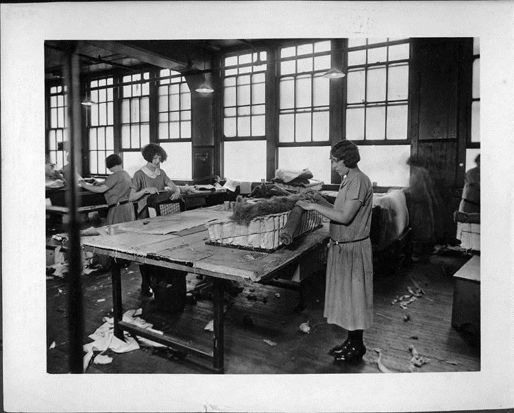 Women working in Packard upholstery department, 1925