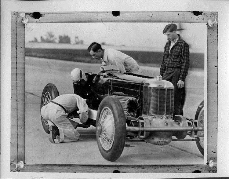 1928 Packard race car being checked on track