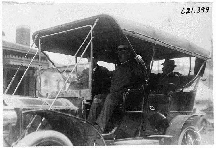 Participating driver in 1909 Glidden Tour automobile parade, Detroit, Mich.