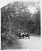 1907 Packard 30 Model U rounding the corner