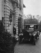 1920 Packard sedan, on drive in front of stone home