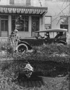 1921-1922 Packard touring car parked in front of stone building