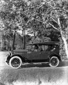 1921-1922 Packard touring car on country road, male driver, four female passengers