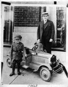 1924 Packard toy car runabout, pictured with man and small boy