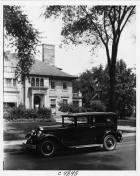 1930 Packard sedan, nine-tenths left side view, parked on street in front of house