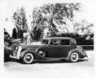 1936 Packard club sedan, parked on drive, gateway in left background