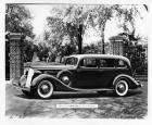 1936 Packard limousine, parked in front of gated driveway