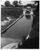 1937 Packard at Packard Proving Grounds on water-covered road