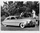 1949 Packard sedan with 1899 Packard Model A in background