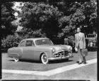 1951 Packard 200 sedan, parked on grass, man standing near front of car