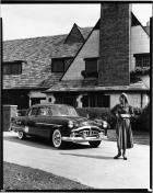1951 Packard Patrician 400, parked in driveway of house, female standing near front of car